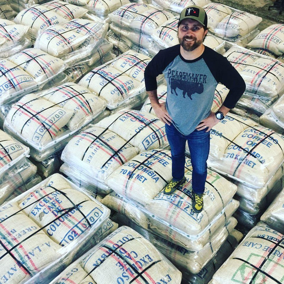 Evan Hafer inspecting coffee beans. (photo courtesy of Evan Hafer)