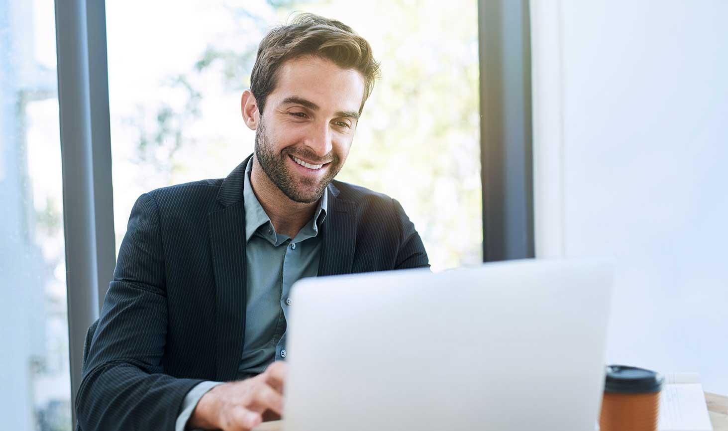 Business-man-behind-laptop-lowres-cropped.jpg