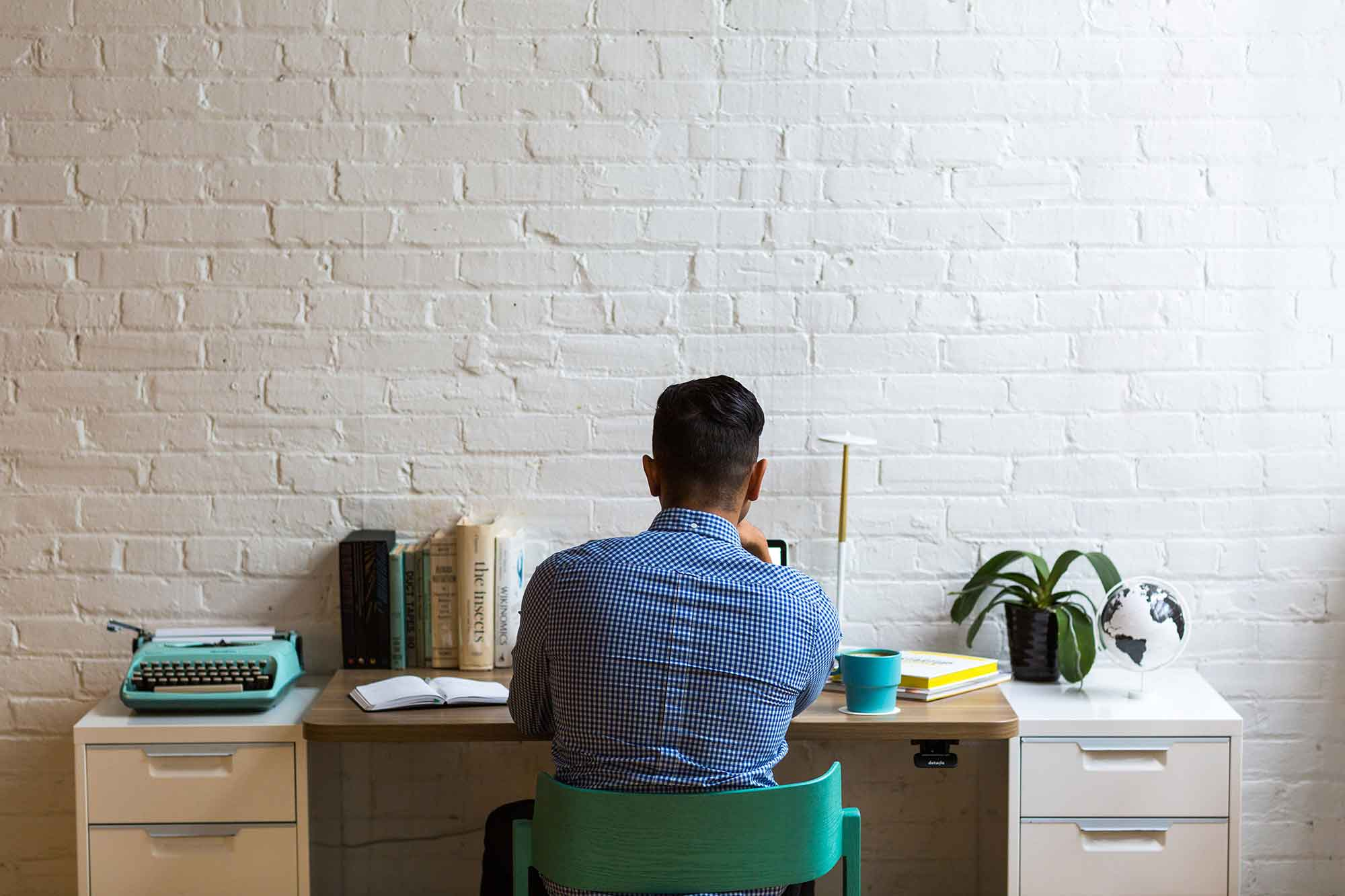 Man-at-Desk-in-White-room.jpg
